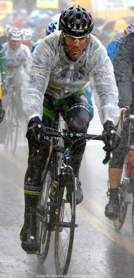 The cold, wet conditions of the final stage couldn't keep Mario Cipollini from smiling, or is that grimacing.