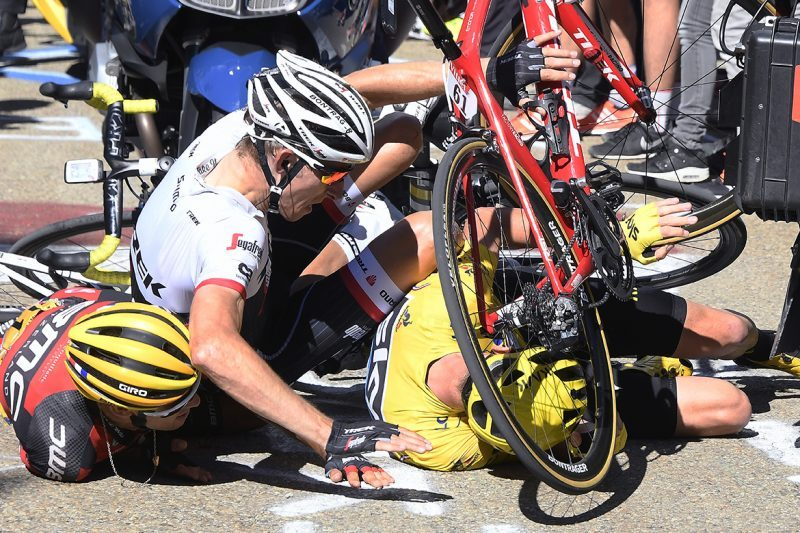 Porte, Froome and Mollema on the floor. Caused by the TV moto, and other photographer motor being stopped by the crowds spilling all over the road. Photo©Tim De Waele